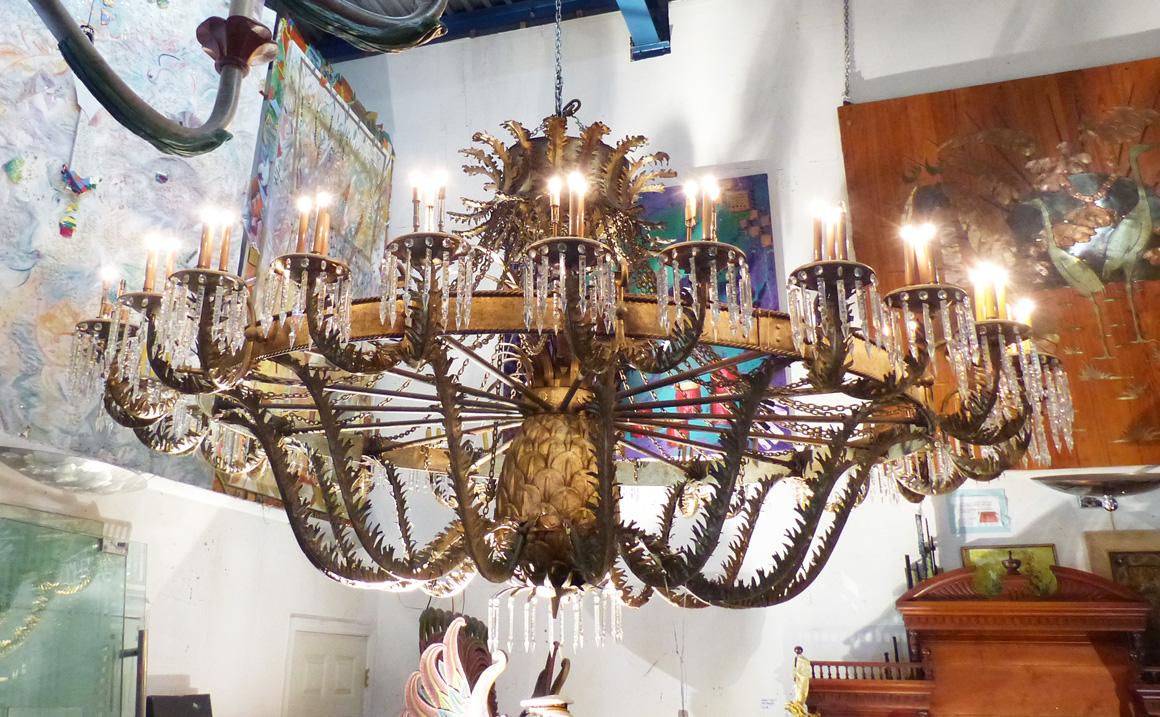 A large gilded iron and crystal ballroom chandelier lighting a large gilded iron and crystal ballroom chandelier lighting arubaitofo Choice Image