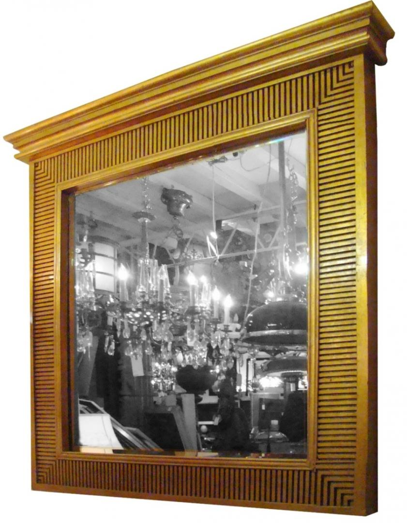 mirror with a gold wood fluted frame